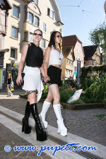 Pupet and her friend goes for a walk in their chastity belts
